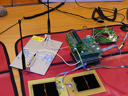 Showing the PA and RF Boards, the test antennas in their jig, two test solar panels, and the ANTS